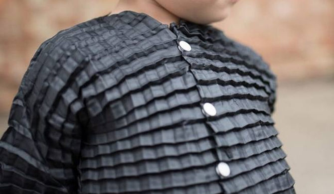 Clothes that grow with your child (Video)