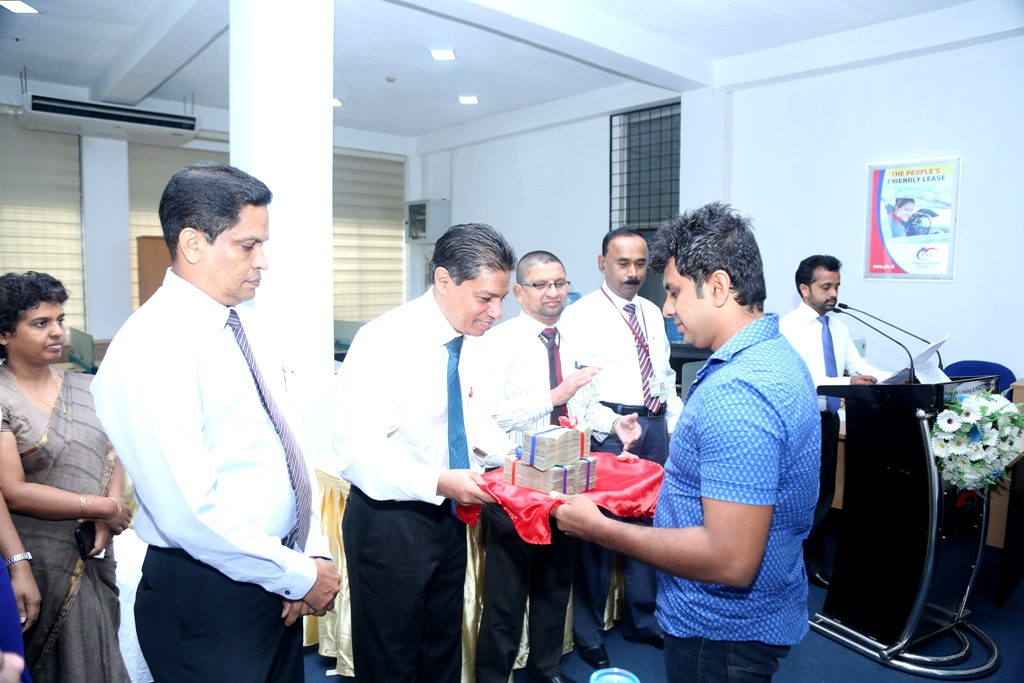 PLC Aluthgama branch opening First transaction by CEO Mr. Sabree