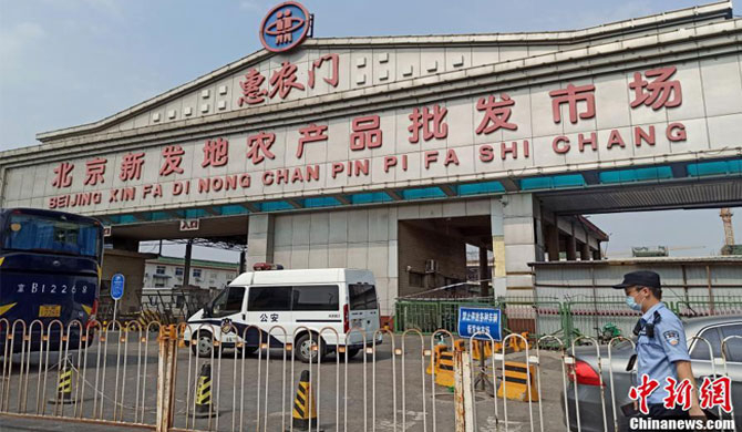 Beijing closes markets over new COVID-19 cases