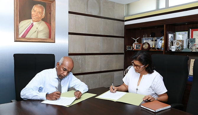S.R. Gnanam - Managing Director of Tokyo Cement Company (Lanka) PLC Shalini Wickramasuriya, Trustee of The Music Project signs the sponsorship MOU