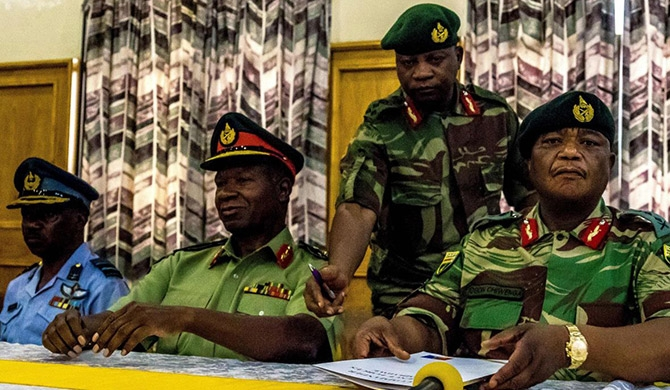 Valerio Sibanda, commander of the Zimbabwe National Army, and Constantino Chiwenga, commander of the Zimbabwe Defence Forces, address a media conference held at the Zimbabwean National Army Headquarters on Monday in Harare, Zimbabwe.