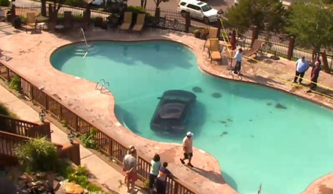 Car splash: Motorist drives into Colorado Springs swimming pool