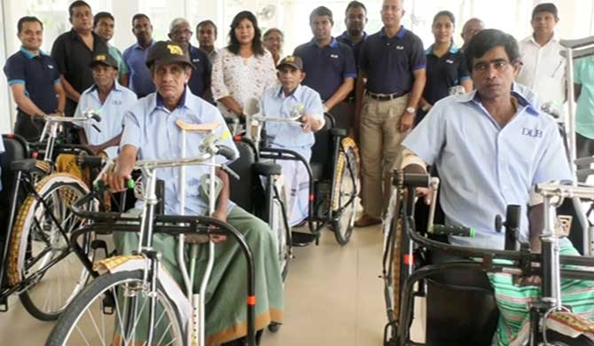 DLB grants tricycles to differently abled sales assistants