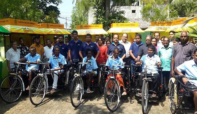 DLB distributes sales outlets, tricycles to Galle (Pics)
