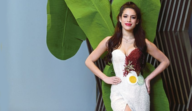 Spiced up : Beauty queen wears national dish