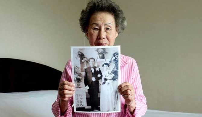 Lee Chun-ja with a picture of her wedding she intends to give to her relatives in North Korea