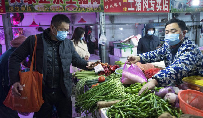 Chinese economy shrinks ; Wuhan death toll up by 50%