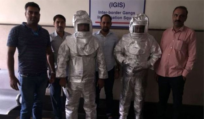 India police parade 'Nasa conmen' in space suits