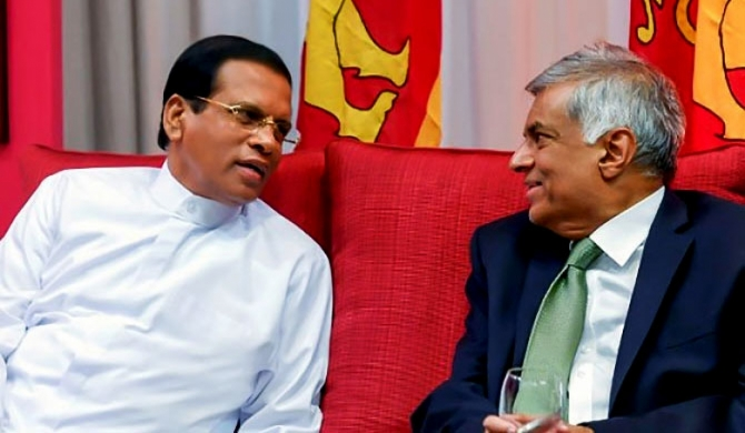 Maithri appoints ministers illegitimately ; Ranil says no Cabinet without him, goes overseas