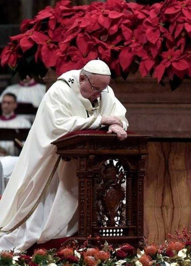 "At a Christmas Eve mass in the Vatican, Pope Francis urged more ""sharing and giving"", denouncing the ""insatiable greed"" of modern consumerism"