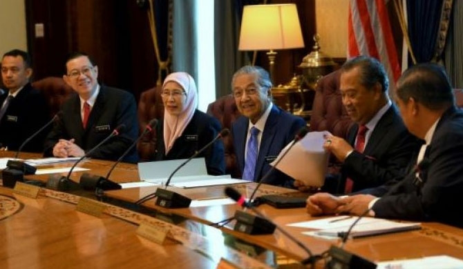 Dr Mahathir (third from right) chairing his first Cabinet meeting at Perdana Putra, on May 23. Also present were (from left) Education Minister Maszlee Malik, Finance Minister Lim Guan Eng, Deputy Prime Minister Wan Azizah Wan Ismail, Home Minister Muhyiddin Yassin and Defence Minister Mohamad Sabu.PHOTO: THE STAR/ASIA NEWS NETWORK
